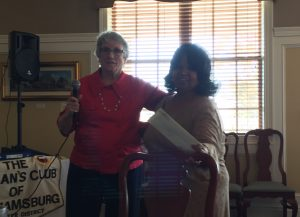 Sally Kellen presents our donation to the WJCC Community Action Agency
